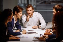 Boss leader coaching in office. On job training. Business and Education concept stock photo