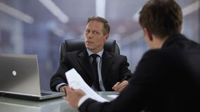 Boss listening male employee talking about profitable project, successful result. Stock footage stock video