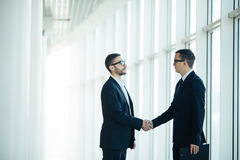 Boss and manager agree handshake. In office panoramic room Stock Photo