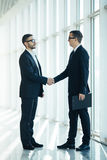 Boss and manager agree handshake in office. Panoramic room Stock Photos