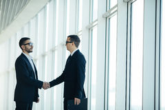 Boss and manager agree handshake. In office panoramic room Stock Images