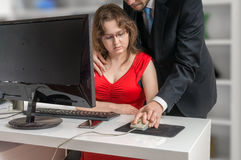 Boss or manager is seducting his secretary in office. Harassment concept. Boss or manager is seducting his secretary in office. Harassment and mobbing concept Royalty Free Stock Photography