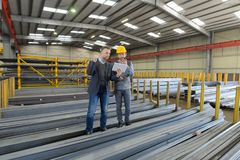 Boss and manual worker in warehouse. Boss and manual worker in the warehouse Stock Images