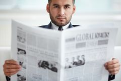 Boss with newspaper Stock Image