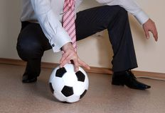 Boss playing football. The boss playing football in a free time in the office Royalty Free Stock Images