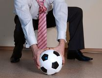 Boss playing football Stock Images