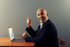 Boss pointing up and smiling Stock Image