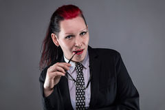 Boss punk woman with glasses. On gray background stock photography