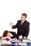 Boss ranting over sleeping employee stock photo