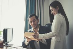 Boss receiving gift package delivery in office. Boss is receiving gift package delivery in office stock photos