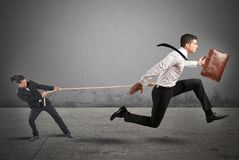 Boss retains employees. Boss tries to strongly retain his employees stock photo