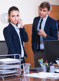 Boss scolding employee for mistakes Royalty Free Stock Image