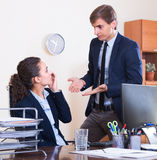 Boss scolding employee for mistakes Stock Images