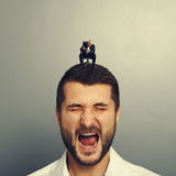 Boss screaming at big businessman Stock Photography