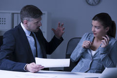 Boss screaming at employee. Physical pressure at work- boss screaming at female employee Stock Photo