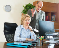 Boss screaming at mature assistant Stock Images
