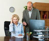 Boss screaming at mature assistant Stock Photography