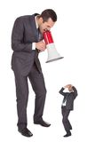 Boss screaming in megaphone at employee Royalty Free Stock Photos