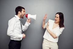 Boss screaming in megaphone at the woman stock images