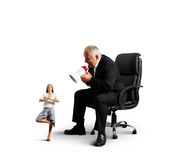 Boss screaming at small meditation businesswoman Royalty Free Stock Image