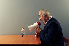Boss screaming at woman in the office Stock Image