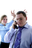 Boss & secretary. Young man and woman in office Royalty Free Stock Image