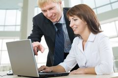 A boss and a secretary. A secretary uses laptop Stock Photography