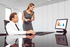 Boss and secretary. Boss helping secretary to type document correctly at meeting Stock Photo