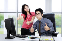 Boss and secretary showing thumbs up Royalty Free Stock Photos