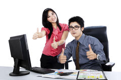 Boss and secretary showing thumbs up 2 Royalty Free Stock Image