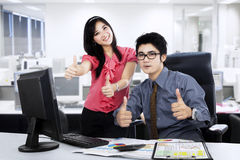 Boss and secretary showing thumbs up 1 Stock Images