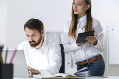 Boss and secretary with a talbet Stock Image