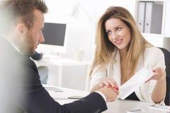 Boss seducing her employee in suit Stock Photography
