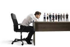 Boss selects suitable candidates to the workplace. Concept of recruitment and team. Boss selects suitable candidates to the workplace. Concept of recruitment and stock photos