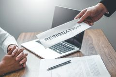 Boss Send a resignation letter to Business woman stressing for quit a job packing the box and leaving the office , Resignation. Boss Send a resignation letter to stock photo