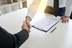 Boss shakehand to a new work who just pass interview. Boss shakehand to a new work who just pass job interview Royalty Free Stock Photography