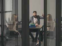 Boss shout at accountant in office. Boss man and woman discuss company budget and money crisis, business conflict and. Boss shout at accountant in office. Boss royalty free stock image