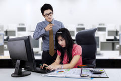 Boss shouting at employee. Boss shouting at his employee in workplace Stock Photos