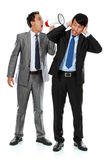Boss shouting over his employee's ear Stock Image