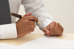 Boss sign a contract. stock photography