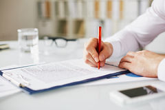 Boss signing contract Stock Photography