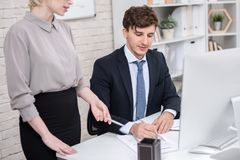 Boss Signing Documents royalty free stock photo