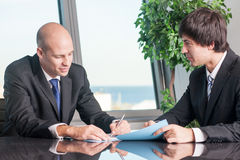 Boss signing documents Royalty Free Stock Image