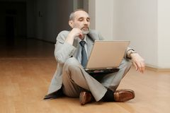 Boss sitting on the floor Stock Photography