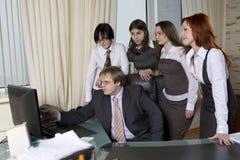 Boss sitting at his desk Royalty Free Stock Photos