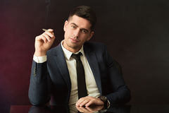 Boss with smirk smoking cigarette Royalty Free Stock Photography