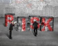 Boss speaker yelling employee pushing jigsaw blocks red RISK wor Stock Photos