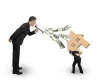 Boss spraying out dollar bills yelling at employee carrying hous Stock Photography