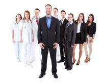 Boss standing on front of his team Stock Photography
