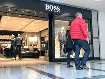 BOSS store. Hugo Boss AG, often styled as BOSS, is a German luxury fashion house headquartered in Metzingen, Germany. It was founded in 1924 by Hugo Boss and royalty free stock photos
